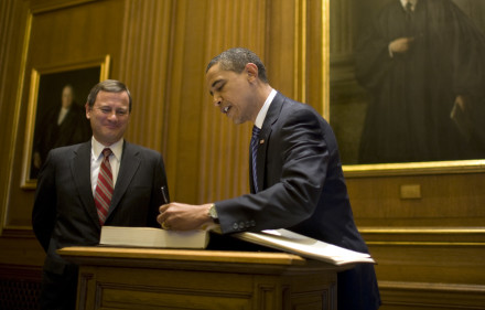 President-elect Barack Obama signs a guest book as Chief Justice John Roberts Jr. looks on during a visit to the U.S. Supreme Court in Washington, D.C. on Weds. Jan. 14, 2009. Painting is of William Howard Taft, the only man to serve as President and Chief Justice.  (Photo by Pete Souza/Obama Transition Team)