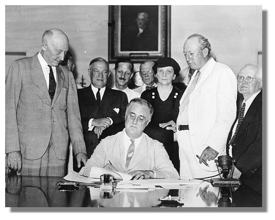 Roosevelt signs the Social Security Act (from Wikimedia Commons)