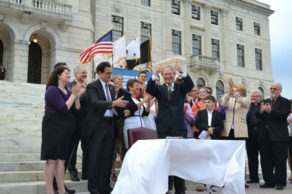 Gov. Chafee signs marriage equality into law.