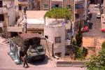 Lebanese police patrolling a Syrian refugee camp. Public Use.