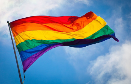 Rainbow LGBT+ flag outside San Francisco's Castro District. By Benson Kua, Flickr. Creative Commons License.