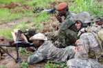 US forces watches weapons training for a member of a Malian counter-terrorism unit.