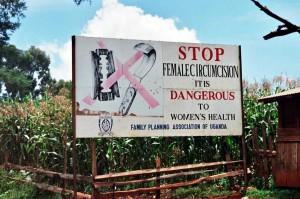 A road sign against female genital mutiliation in Uganda. Amnon Shavit, Wikimedia Commons, Creative Commons.