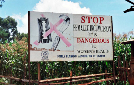 A road sign against female genital mutiliation in Uganda. Amnon Shavit, Wikimedia Commons, Creative Commons.