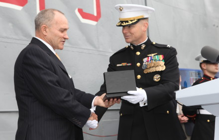 Colonel Mark J. Desens, commanding officer Special Purpose Marine Air Ground Task Force 26, presents Raymond W. Kelly, New York City Police Commissioner and the guest of honor, with a SPMAGTF-26 and USS New York plaque during a cake-cutting ceremony aboard the Intrepid Sea, Air & Space Museum in New York City Nov. 10, 2009. Festivities included drill movements from SPMAGTF-26 Marines, guest speakers and a cake-cutting ceremony. SPMAGTF-26 is made up of North Carolina Marines from several units and was formed to support the commissioning of USS New York.(Official USMC photo by Cpl. Jesse J. Johnson)(Released)