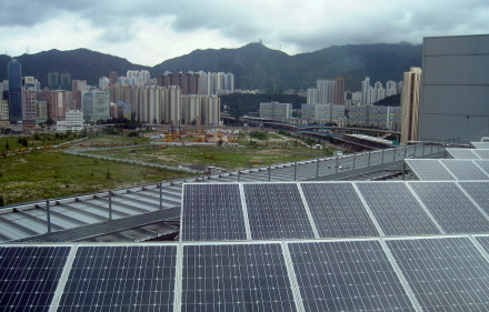 Solar panels over a Chinese city. Renewable energy has proven that it cannot support torrid Chinese growth.