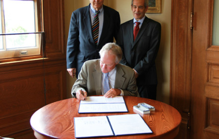 Rhode Island Gov. Lincoln Chafee signs the Interstate Compact.