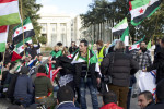 Protesters at the Geneva II Conference on Syria. Notice the flags of Syrian Kurdistan. Image by Frederic Jacobs.