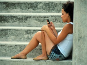 A Cuban young woman uses her mobile phone in Havana.  STR/AFP/Getty Images Creative Commons License