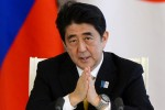 Japanese Prime Minister Shinzo Abe speaks during joint news conference with Russia's President Vladimir Putin in Moscow on April 29, 2013. Japanese Prime Minister Shinzo Abe and Russian President Vladimir Putin on Monday pledged to renew efforts to find a solution to a decades-long territorial row that has prevented the two sides from signing a World War II peace treaty. AFP PHOTO/POOL/KIRILL KUDRYAVTSEV        (Photo credit should read KIRILL KUDRYAVTSEV/AFP/Getty Images)