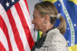 Secretary Clinton speaks to Italian foreign minister in one of her signature scrunchies in 2012.