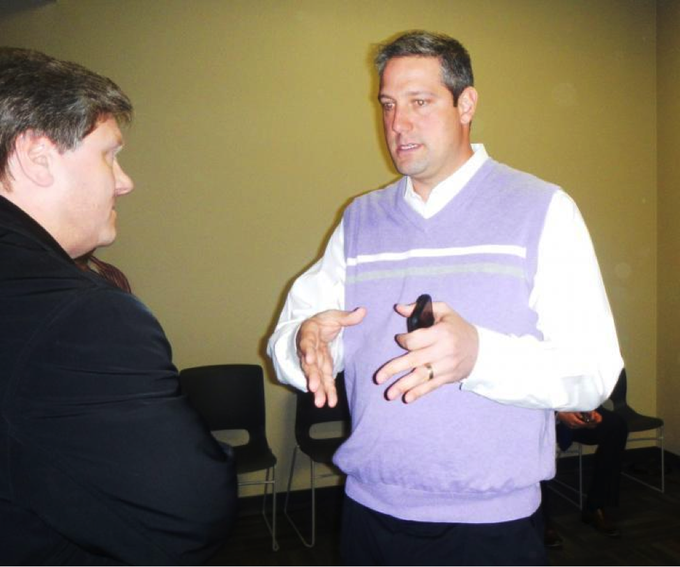 "Congressman Tim Ryan is pictured here talking to a constituent. In an interview with BPR, Ryan said that he enjoys the ability of social media to ""meet the people where they're at"" via Twitter and Facebook, platforms that simulate the humanistic characteristic of face-to-face interactions like these."