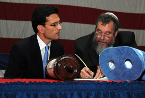 Eric Cantor with a rabbi and a Torah.