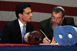 Eric Cantor with a rabbi and a Torah.