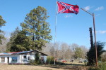 The Confederate Battle Flag still flies high in much of the South.