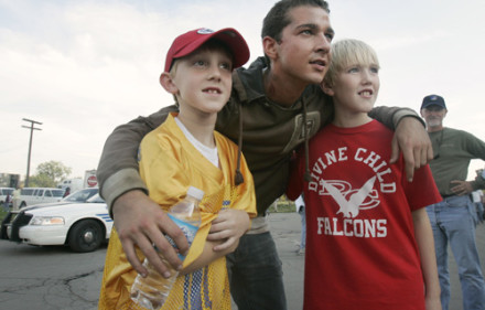 "CAPTION INFORMATION Actor Shia LaBeouf poses for a photo with Jack Sydorchuk (left), 7, and his brother Max, 11, both of Dearborn Heights, who came down to watch the filming.  Hollywood Director Michael Bay and actor Shia LaBeouf (cq) film a scene from the new movie ""Transformers"" in front of the derelict Michigan Central Depot in Detroit, Michigan on October 3, 2006. Also, some filming on Fort Street in downtown.  (Brandy Baker / The Detroit News)"