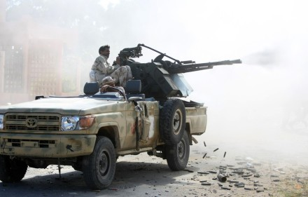 A Libyan National Transitional Council (NTC) fighter fires a heavy machine gun at forces loyal to former leader Moamer Kadhafi during battles in the neighbourhoods of Dollar and Number 2 in Sirte on October 17, 2011. AFP PHOTO/AHMAD AL-RUBAYE (Photo credit should read AHMAD AL-RUBAYE/AFP/Getty Images)