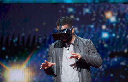Jeremy Bailenson (not shown) demonstrates a virtual reality headset with help from host Baratunde Thurston at TED Talks Live - Science and Wonder, November 5-6, 2015, The Town Hall, New York, NY. Photo: Ryan Lash/TED