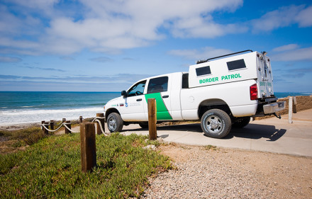 """Taken at the US/Mexican Border at Border Field State Park in Southern California.  US Border Patrol vehicle parked above the beach and the fence that divides Mexico and the US.  Richard Wong and I talked with the gentleman in the truck for quite some time.  He told us all sorts of stories and gave us a much better understanding for the situation at these International Borders.  I won't go into the specifics of what was said because it was understood that he wasn't """"on record (not that any of it was bad in any way).  I asked him for a portrait, but he understandably declined."""