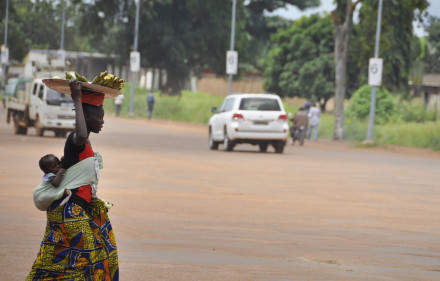 While the UN is warning that the elements of genocide are presesnt in the ongoing conflict in the Central African Republic, life must continue as usual for many residents. A banana seller carries her child as she contiues to work on the streets of Bangui.