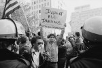 Man_holding_sign_during_Iranian_hostage_crisis_protest,_1979